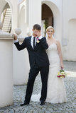 Bride and groom funny portrait outdoors Royalty Free Stock Images