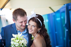 Bride and groom is laughing near the glass Royalty Free Stock Photo