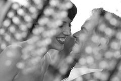 Bride and groom laughing Stock Photos