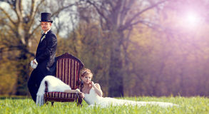 The bride and groom on the lawn in the forest Stock Images