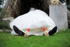 Bride and groom laying in a hut Royalty Free Stock Photography