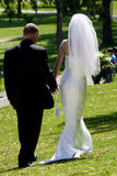 Bride & Groom Leaving... Bride & Groom leaving the wedding ceremony Royalty Free Stock Photo