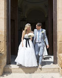 Bride and Groom leaving the church Stock Images