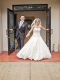 Bride and groom leaving church Stock Photos
