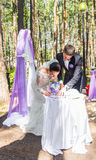 Bride and groom leaving their signatures on wedding ceremony stock images