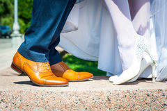 Bride and groom legs Stock Photos