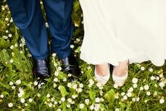 Bride and groom legs stock photo