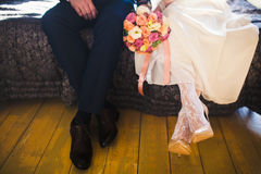 Bride and groom legs stock photo