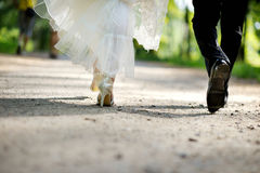 Bride and groom legs. Walking away Royalty Free Stock Photography
