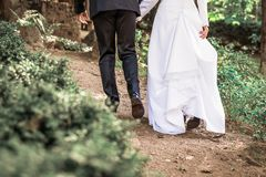 Image of Bride and groom legs walking away stock photography