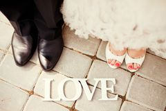 Bride and groom legs Royalty Free Stock Images