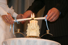 Bride and groom light one candle family Stock Photo