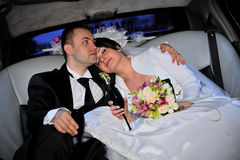Bride and groom in limo Stock Images