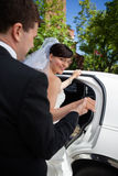 Bride and Groom with Limo Stock Image