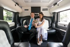 The bride and groom in limousine Royalty Free Stock Images