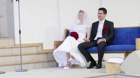Bride and groom listening to wedding sermon stock video