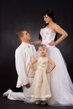 Bride, groom and little bridesmaid Stock Photography
