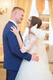 Bride and groom look at each other Royalty Free Stock Photos