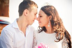 Bride and groom look into eyes Royalty Free Stock Photos