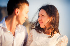 Bride and groom look into eyes Royalty Free Stock Photo