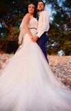 Bride and groom look at the sunset Stock Photo