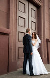 Bride and groom looking at each other Royalty Free Stock Photography
