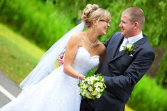 Bride and groom looking each other Stock Photography