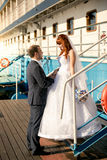 Bride and groom looking at each other on deck of cruise ship Royalty Free Stock Photography