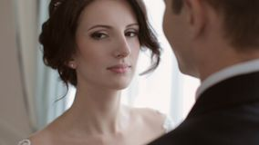 Bride and groom looking at each other stock video footage