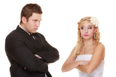 Bride and groom looking at each other offended Royalty Free Stock Photography