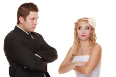 Bride and groom looking at each other offended Stock Images