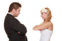 Bride and groom looking at each other offended Stock Image