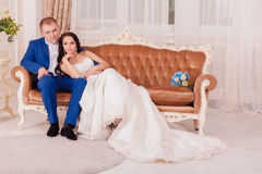 Bride and groom looking fondly of each other indoor royalty free stock photography