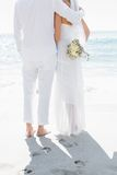 Bride and groom looking out to sea Royalty Free Stock Photo