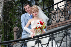 Bride and groom looking at somewhere and smiling. Portrait. Outside Stock Image