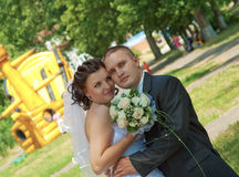 Bride and groom looks into the camera. Stock Photography