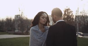 Bride and groom in love looking at each other at park in slow motion. 4k stock video footage