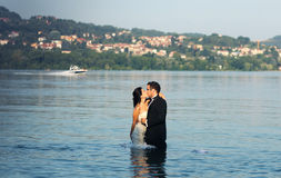 Bride and groom love. Lovely beautiful bride and groom in water Stock Image