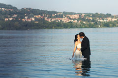 Bride and groom love. Lovely beautiful bride and groom in water Royalty Free Stock Photography