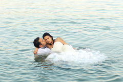 Bride and groom love. Lovely beautiful bride and groom in water Royalty Free Stock Photo