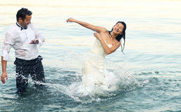 Bride and groom love. Lovely beautiful bride and groom in water Royalty Free Stock Photos