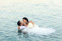 Bride and groom love. Lovely beautiful bride and groom in water Stock Photography