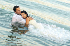 Bride and groom love. Lovely beautiful bride and groom in water Royalty Free Stock Image