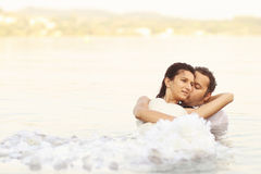 Bride and groom love. Lovely beautiful bride and groom in water Stock Images