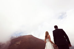 Bride and groom love on mountain Stock Photos