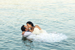 Bride and groom. Lovely in water Royalty Free Stock Photos