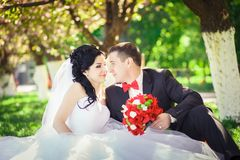 Bride and groom in a lush garden Stock Images