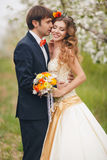 The bride and groom in a lush Park in the spring. Royalty Free Stock Images