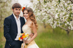 The bride and groom in a lush Park in the spring. Stock Photos