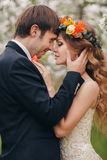 The bride and groom in a lush Park in the spring. Stock Photography